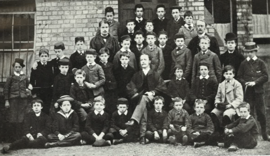 1881. The Headmaster, Mr AE Clarke, the staff and boys of the OPS